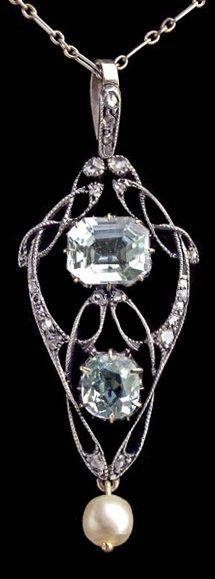 An Art Nouveau platinum, gold, aquamarine, diamond and pearl pendant, by…
