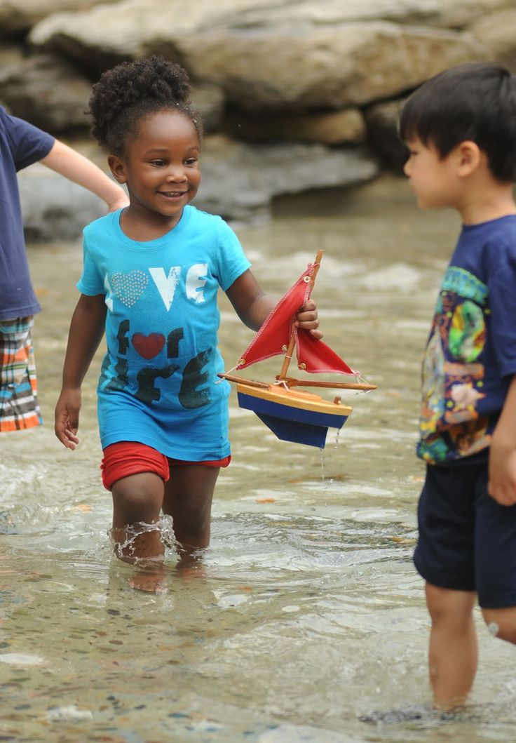 "Children love exploring Sister Cities Park's ""discovery garden"" and splashing in the toy boat pond!"