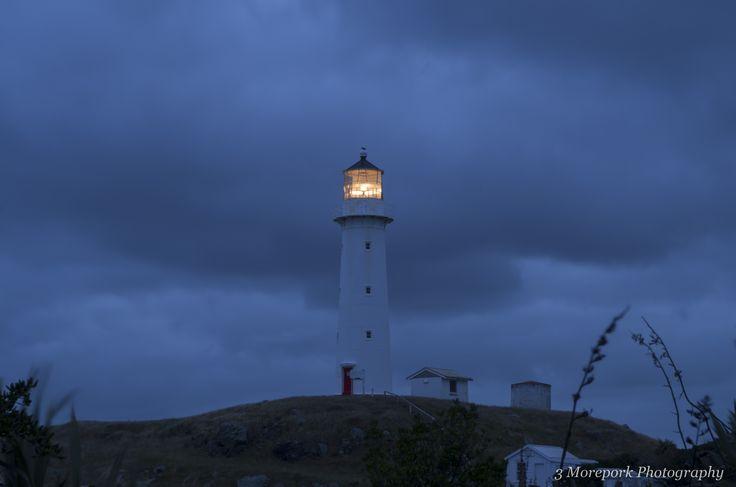 Cape Egmont lighthouse under gathering storm clouds.