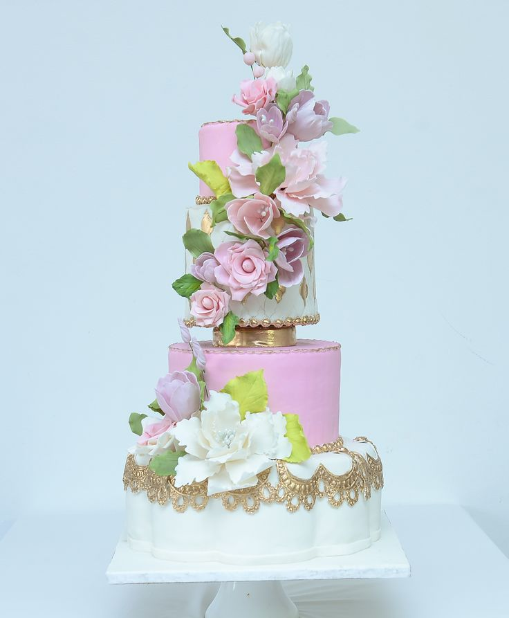 Royal Wedding Cake Pink And White With A Petal Tier Using Ornamental Gold
