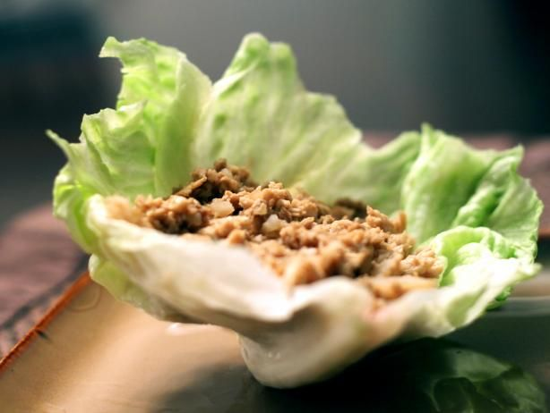 P. F. Chang's Chicken Lettuce Wraps Recipe.  Deep six the olive oil - no need for it - just lightly spray the pan.  8 ounces skinless boneless chicken breast.  Serves 3 people: 386 cal, 10.7 g fat, 2.3 g sat fat, 73 mg cholesterol, 1498 mg sodium (not the best), 45 g carbs, .7 g fiber, 25.5 g protein.  Nutrition grade A-  That's a nifty swap from the original recipe (506 cal, 24.7 g fat)!!