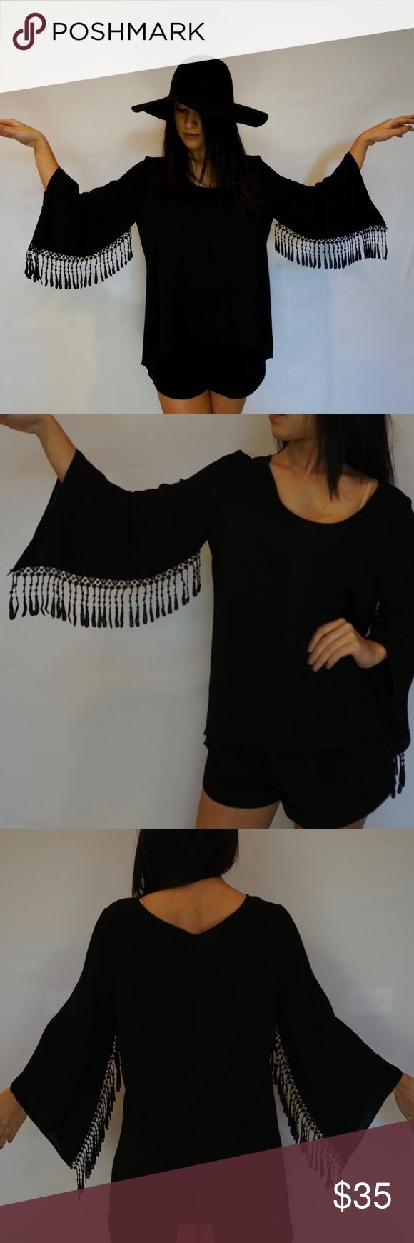 Fringe blouse Long sleeve blouse.  Fringe blouse.  100% polyester.  Great condition.  No brand mentioned. Tops Blouses