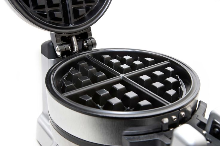 For scrambled eggs on the go, use a waffle iron. Whisk eggs, and mix in chopped vegetables and a dash of milk. Spritz both sides of the waffle iron with cooking spray, and pour in egg mixture. Cook two to three minutes and place in a bagel for a breakfast you can munch on with one hand.