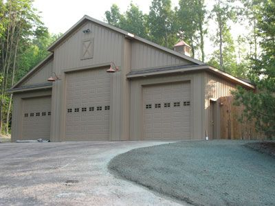 Take the right side garage door and put in large windows,,, perfect for Chauncey's office. Living quarters upstairs.