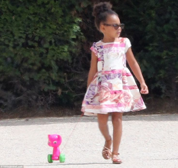 Hello kitty: Blue Ivy walked her kitty toy on wheels during a visit to the Tuileries Garden in Paris with her mom and dad