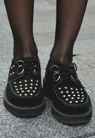 Vintage grunge shoes with studs.