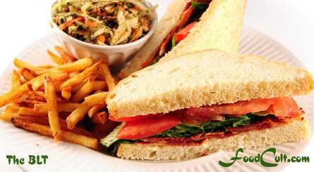 The classic Bacon Lettuce and Tomato Sandwich (the BLT) with fries 'n slaw