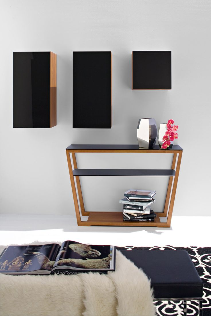 ELEMENT is a hallway console table with matching finish tempered glass top and shelf. Element features a trapezoidal wooden frame with a base that can be used as an extra shelf. #calligaris #modern  #console