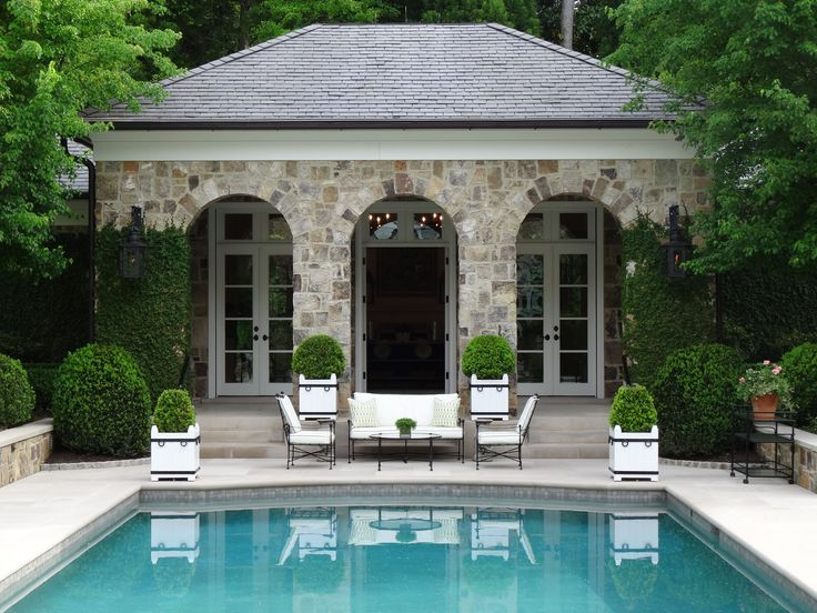 Pool, limestone terrace and custom box planters by Howard Design Studio, landscape architects. Cabana by Norman D. Askins Architects.