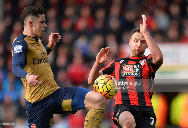 Arsenal's Brazilian defender Gabriel (L) vies with Bournemouth's English midfielder Marc Pugh during the English Premier League football match between Bournemouth and Arsenal at the Vitality Stadium in Bournemouth, southern England on February 7, 2016. / AFP / GLYN KIRK / RESTRICTED TO EDITORIAL USE. No use with unauthorized audio, video, data, fixture lists, club/league logos or 'live' services. Online in-match use limited to 75 images, no video emulation. No use in betting, games or…