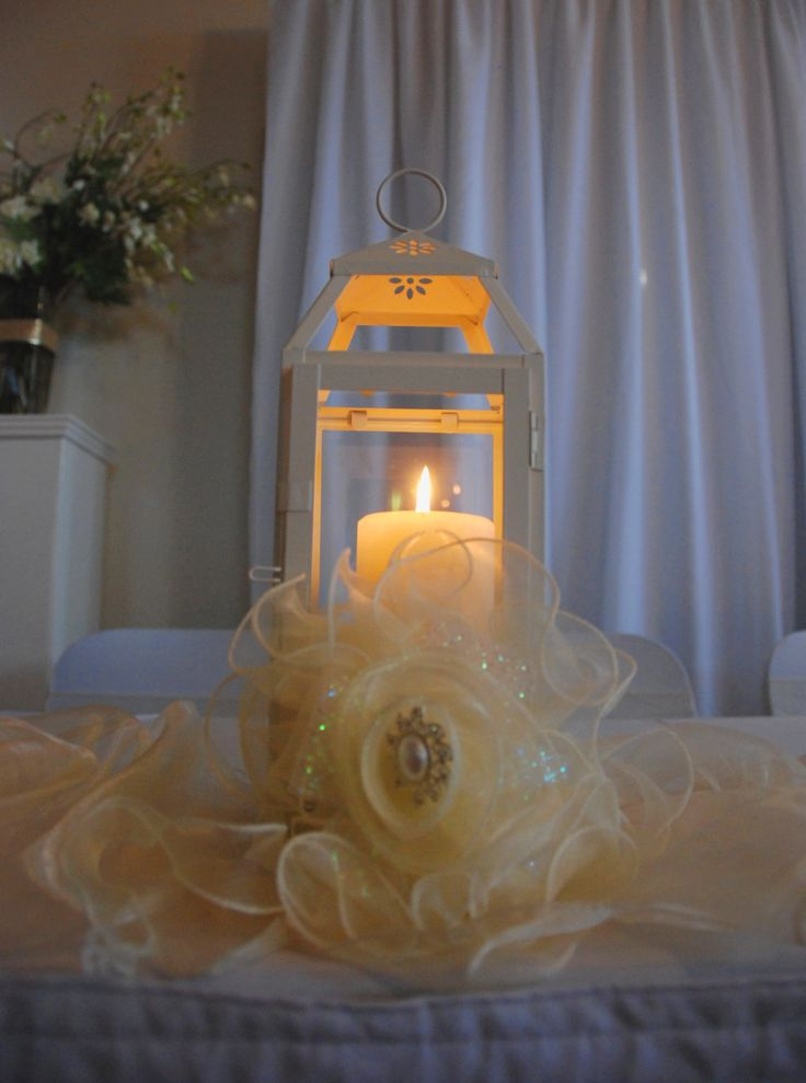 Candle light sets a romantic glow in our Cream Metal Lanterns