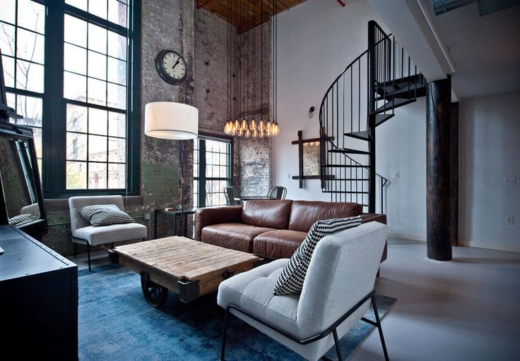 Industrial Atlanta loft apartment.Unfinished wood and exposed brick with accents of metal and leather make this the bachelor pad you've always wanted.