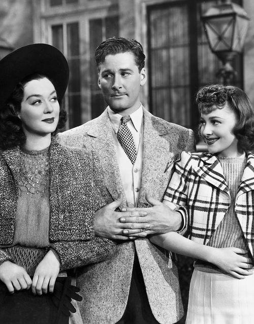warnerarchive: Rosalind Russell, Errol Flynn and Olivia de Havilland in Four's a Crowd (1938)
