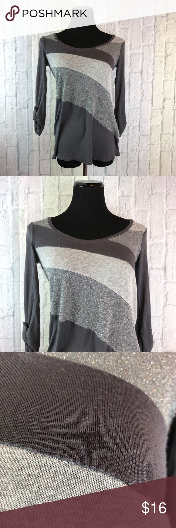 "✨Ella Moss Sparkly Blouse✨ Item #: 48  YOU ARE BUYING: Ella Moss Top  STYLE: 3/4 Sleeve Blouse   COLOR: Gray/silver   SIZE: Small  CONDITION: pre-loved. Small bleach stain on front. Washed and worn several times.    MEASUREMENTS ⤵️   PIT TO PIT: 17""  LENGTH: 23""  PIT TO SLEEVE: 14.5"" Ella Moss Tops Blouses"