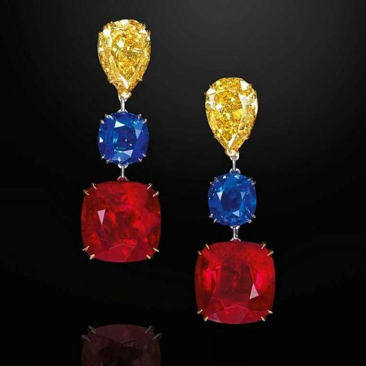21.35 carat Fancy Vivid Yellow, Kashmir Sapphire and Burmese Ruby Earrings. Ronald Abram, Hong Kong.