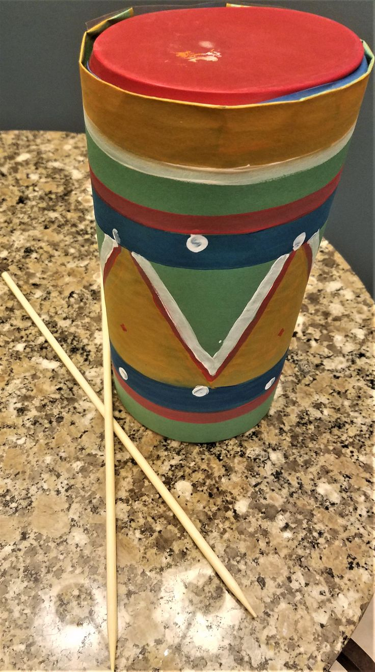I made a homemade drum using an empty Lysol wipe container