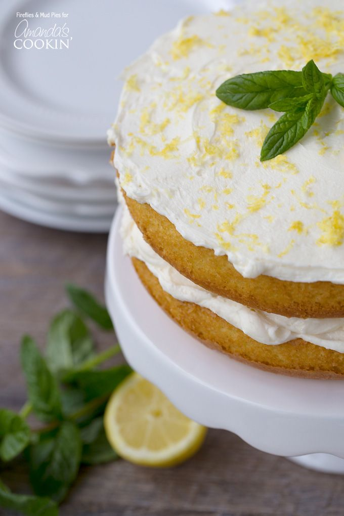 This beautiful Lemon Curd Poke Cake is easy to make. It starts with a cake mix and is doctored into a beautiful lemon dessert worthy of party status. | Amanda's Cookin'
