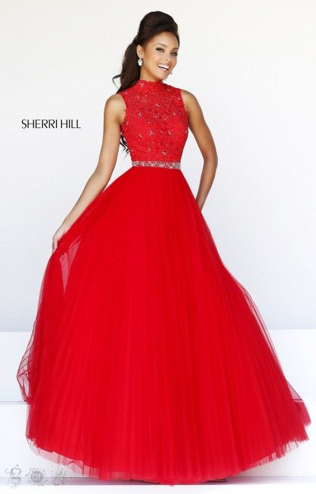We are loving how sweet and whimsical Sherri hill 21334 is! This dainty lace and tulle dress would be perfect for your next prom, sweet sixteen, or big event! The combination of a lace bodice, high neckline and tulle skirt gives it a true angelic and conservative feel. Along the waist line is a belt made out of silver crystals giving you just the perfect touch of bling! The open back completes the dress!: