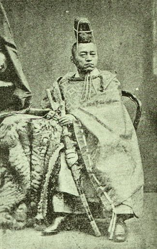 Japanese antique photograph. Iwakura Tomomi (1825 - 1883). He was a Japanese court noble and was a politician. He made an effort for restoration of the Emperor system of Japan. His portrait has been drawn on the Japanese paper money. Edo era (Bakumatsu) / Meiji era.
