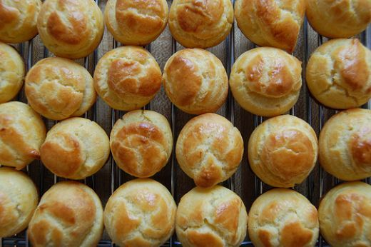 "Choux (pronounced ""shoe"") pastry, or puff pastry, is the basis of a number of great pastry delicacies, including cream puffs (profiteroles), eclairs, and some types of turnovers (others use phyllo dough).  Here's a simple recipe you can use:  Choux..."