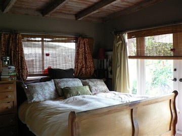 Spanish Style Relaxation Of A Master Bedroom With Wood