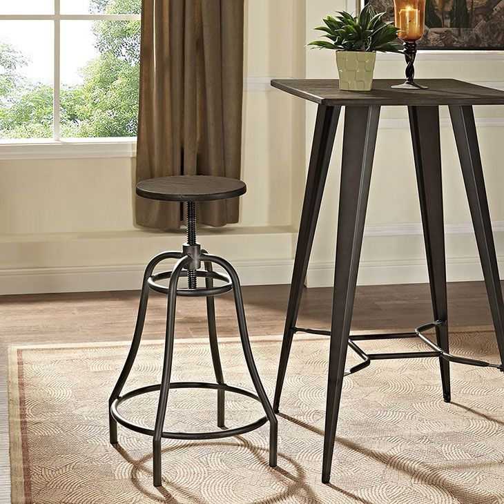 Toll Metal Bar Stool, Brown - Gain access to new liberties with the Toll Bar Stool. Constructed with distressed steel tubing and a round bamboo seat top, Toll resounds with an eclectic mix of industrial and modern elements for a piece of exceptional charm. Toll features a sturdy footring, adjustable seat height, and bell-shaped design for a piece of estimable appeal. Built to compliment the clinking of cocktail glasses, Toll works well in industrial, rustic, farmhouse and shabby bar seating…