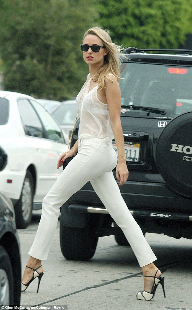 All white: The former Made In Chelsea star teamed the number with crisp white trousers and...