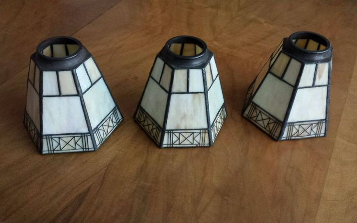 Vintage set of three slag glass and metal lamp shades. All are in good condition with no breaks in the glass, nor damage to the decorative frieze.