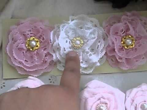 At 4 minutes, she will explain how to make the satin flowers. I also like her lace ones that she made with the lace ribbon. Both flowers are a running stitch to achieve the effect.