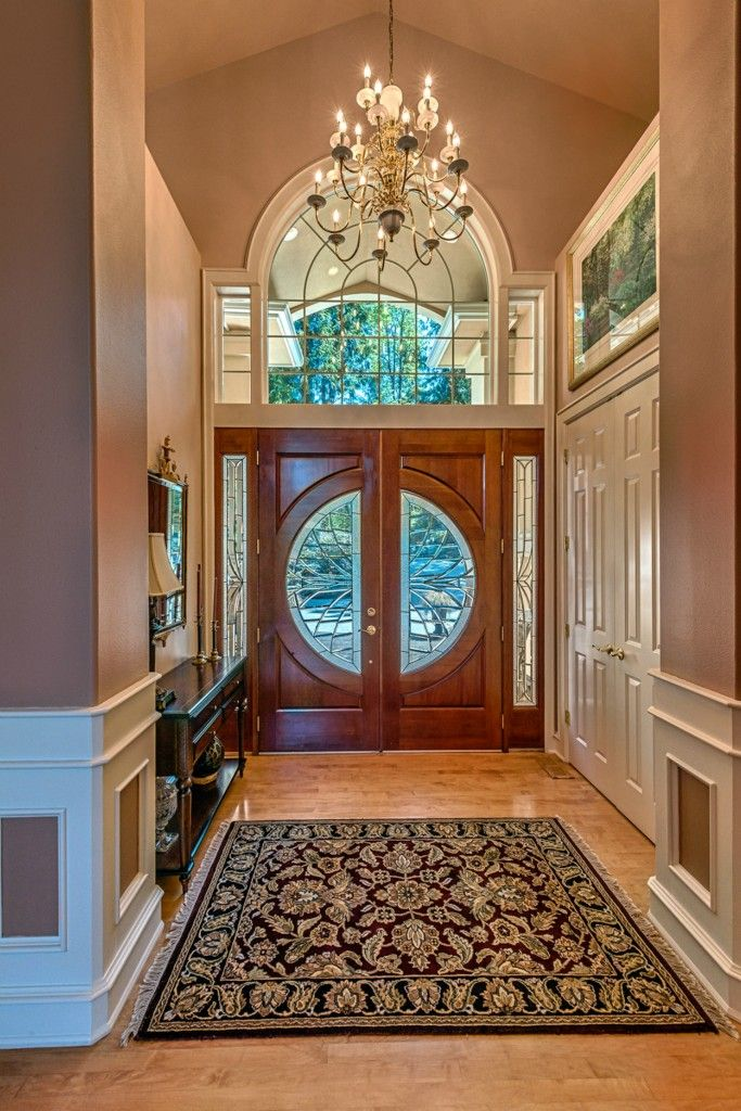 Grand Foyer Lighting : Beautiful grand entryway complete with chandelier