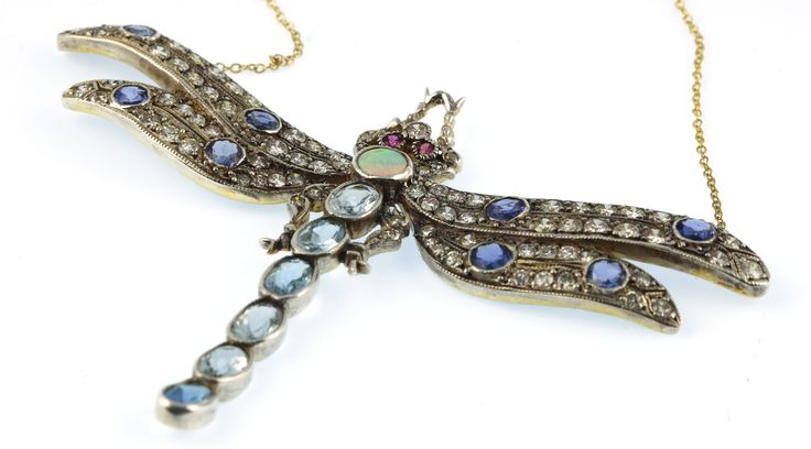 Lot 735, An 18ct yellow gold diamond, ruby, opal, aquamarine and sapphire set dragonfly pendant on a gold chain, est £1200-1400