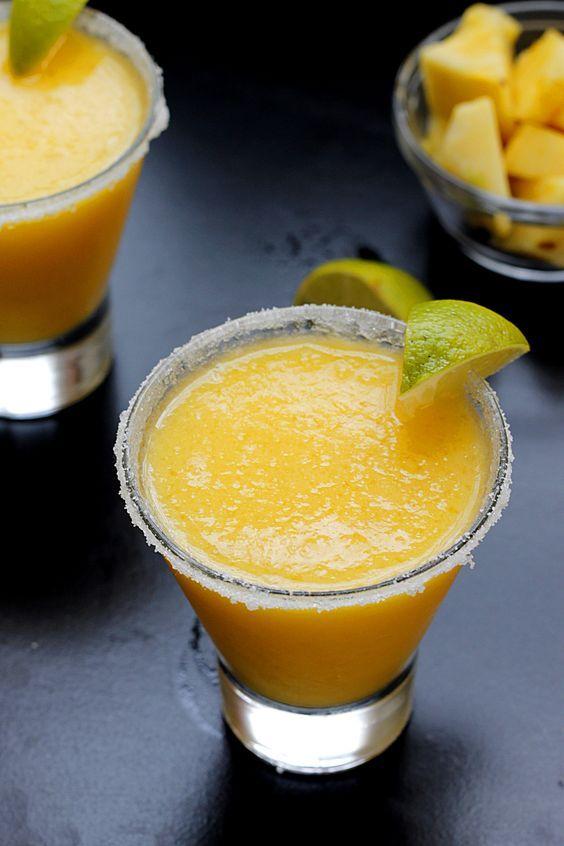 Frozen Pineapple MangoMargarita W/ frozen mango, frozen pineapple, simple syrup, clementine juice, lime, & Silver tequila