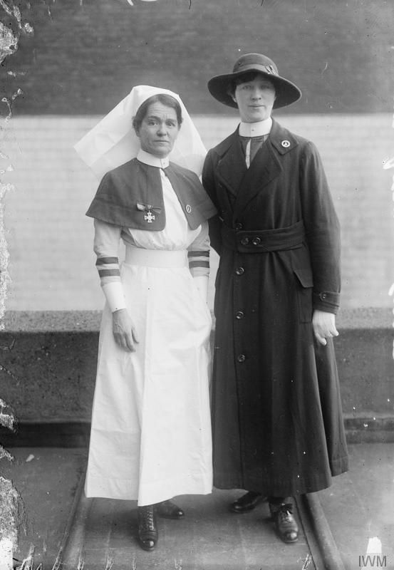 Two female South African Nurses, one wearing the indoor uniform and the other wearing the oudoor uniform.