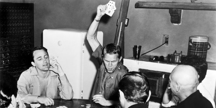 Robert Vaughn, Steve McQueen, Yul Brynner and their Magnificent Seven cast members relax with a game of poker.
