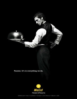 """A waiter. Melia Hotels advertising says """"Passion. It's in everything we do."""" and features staff dancing. Such a great and creative idea! And I like the black and white colours of the pic. Beautiful!"""