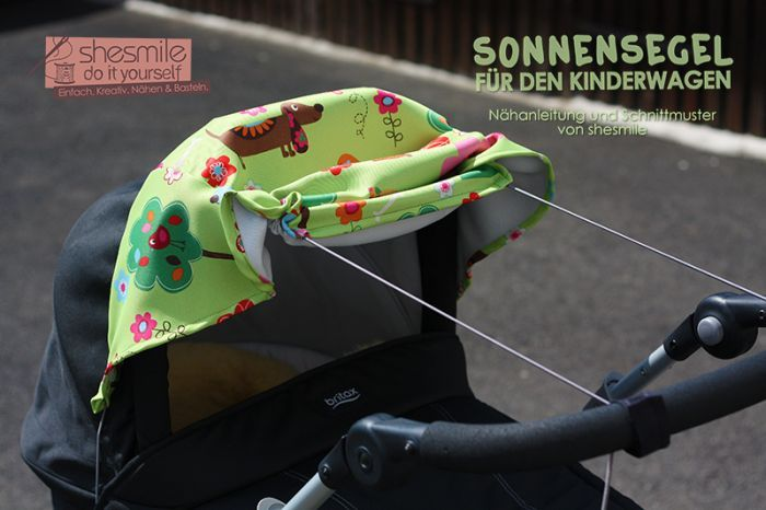 Sonnensegel für den Kinderwagen (Eine Nähanleitung und Schnittmuster von shesmile) Hier genäht aus buntem Verdunkelungsstoff für Kinderzimmervorhänge.