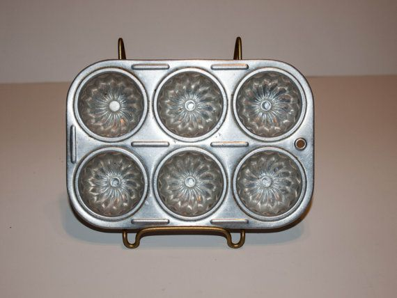 Check out this item in my Etsy shop https://www.etsy.com/listing/204079799/vintage-childs-muffin-tin-muffin-tin