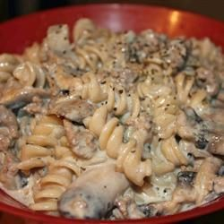 Simple Hamburger Stroganoff Recipe - brown ground beef and mix with all other ingredients in slow cooker.  Serve over rice or pasta