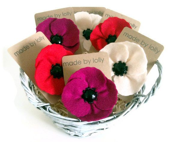 The hot pink felt poppy corsage - a popular favourite, back again in the made by lolly A/W collection