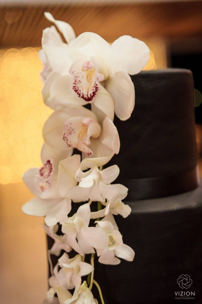 Elize & Stefan Real Wedding Showcase - The Aleit Group  Black and gold wedding. Black wedding cake. White lilly. White lilly cake. Cake Maker. Vizion Photography and Films. Laurent Venue.