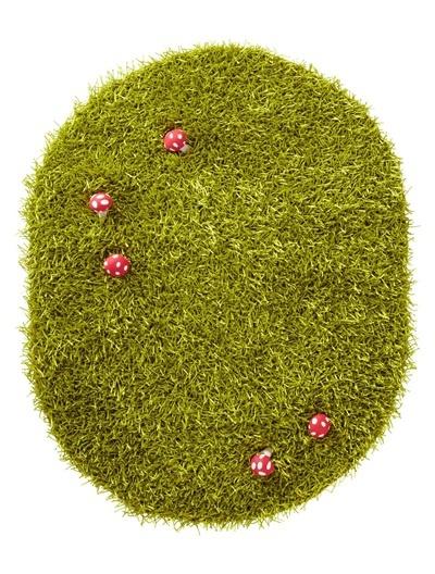 grass rug with raised mushrooms from vertbaudet £59