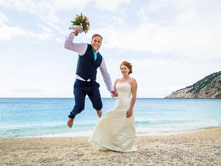 Love this crazy photo - happy groom is happy with the bridal bouquet in his hands #beachwedding #weddingphotos #weddingingreece #mythosweddings #kefalonia