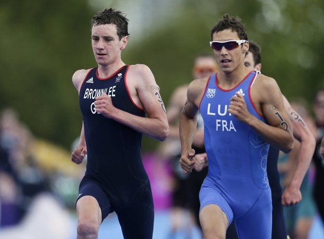 Britain's Alistair Brownlee (L) competes with France's Vincent Luis in the men's triathlon final during the London 2012 Olympic Games at Hyde Park August 7, 2012.