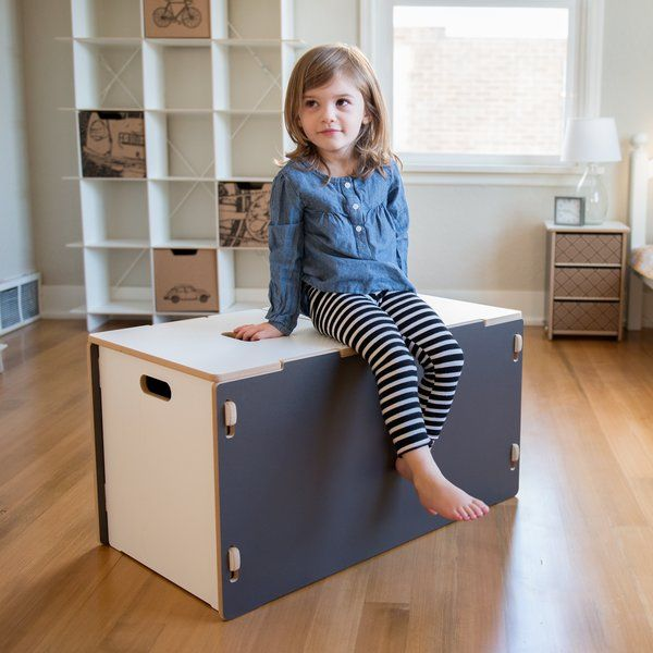 "The modern toy box from Viv + Rae is perfect for playing our favorite playroom game: ""Now you see toys, now you don't!"" Our modern toy boxes have plenty of room, so many toys can be stored neatly out of sight. Little ones can help put things away with the specially designed handles in the middle of the lids that help keep little fingers from getting pinched.Viv + Rae Toy Boxes are simple to assemble with no tools and no hardware and stay solidly together. If you aren't using..."