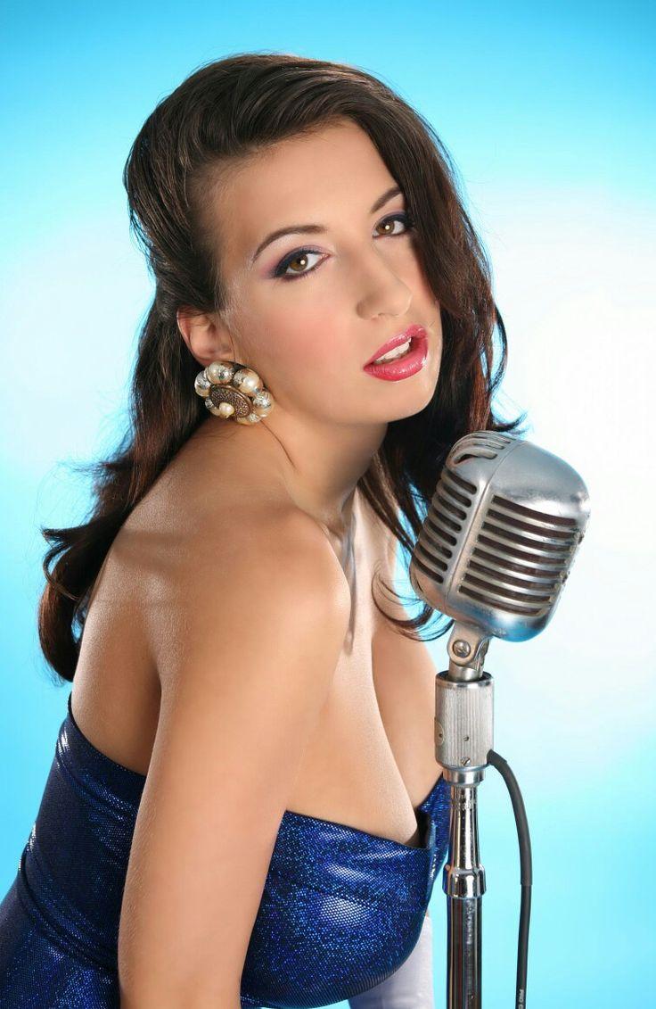 Jana Defi - close-up in tight blue shimmer dress