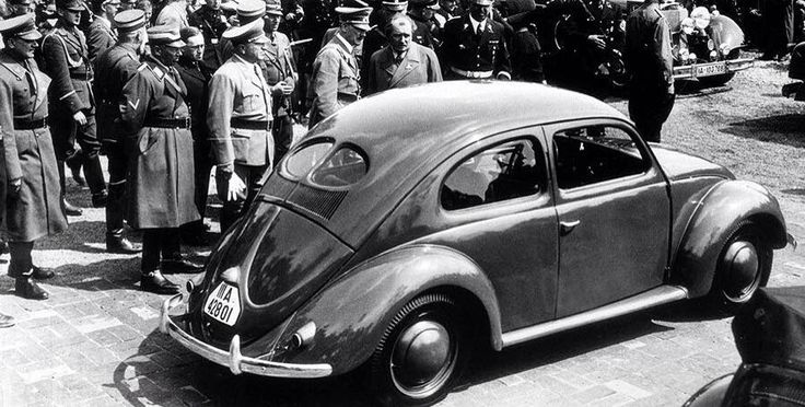 Adolf Hitler, Ferdinand Porsche and many other high ranking officers with the new Volkswagen Beetle, 1938.