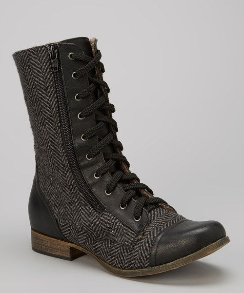 Strut in style with these fashion-forward boots! The cap-toe and herringbone