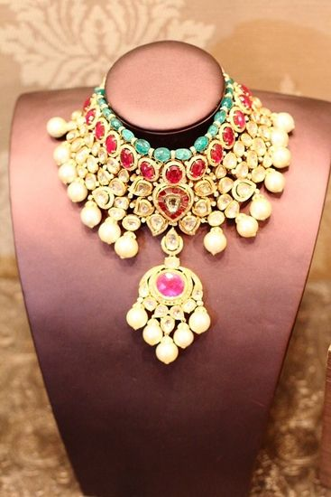 Emeralds and rubies set in regal designs by Rose jewels.