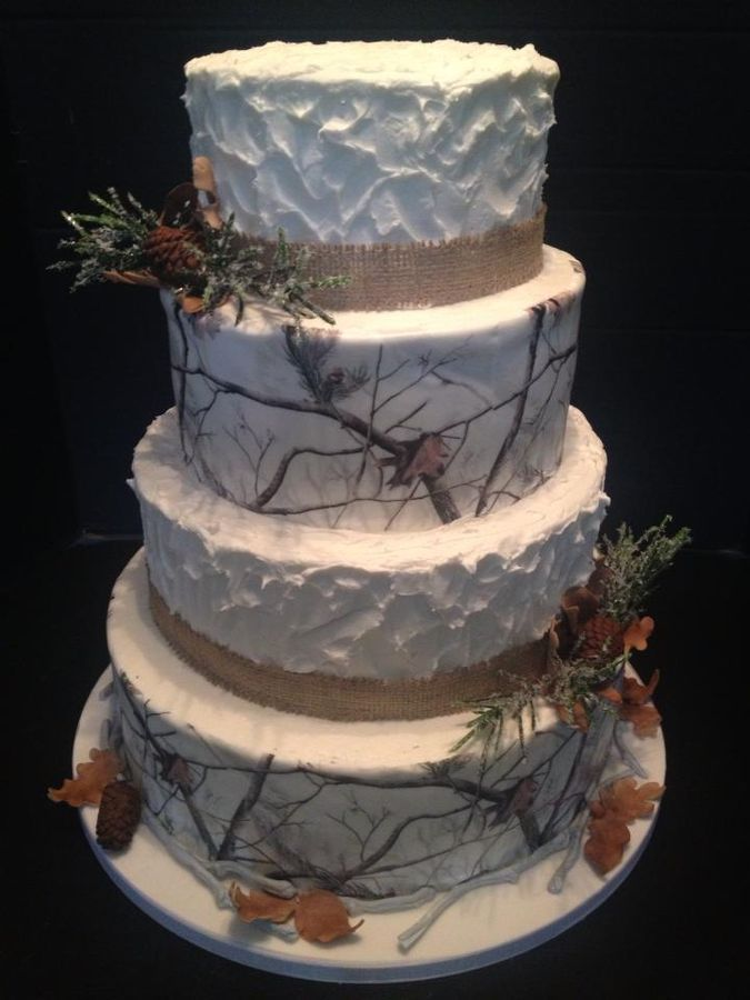 Winter camouflage wedding cake. All accents are gumpaste, camouflage was printed on Lucks edible image sheets which were SO easy to use.