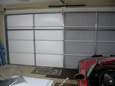 So you cheaped-out and bought an uninsulated garage door? Use Thermax foil-backed foam to insulate a garage door. Power Grab adhesive to bond it tight.